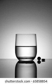 Aspirin and water drop with back-light