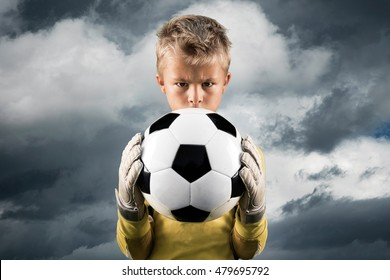 Aspiring young soccer player posing as a goal keeper.