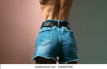 Ass. Female buttocks in jeans stripped. Big sexy sandy. Luxury female back and buttocks. Sensual girl. Sexy ass in jeans, hard style, woman clothes