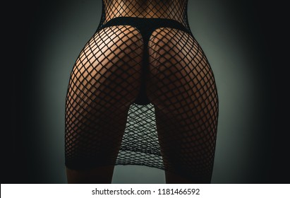 Ass female in panties. Female with sexy ass posing. Erotic ladies fashion concept. She is wearing hot sexy black lingerie with stocking