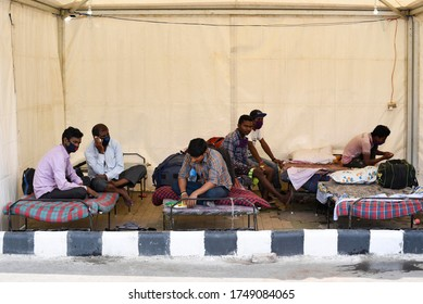 Assam, India. 4 June 2020. Migrants who returned from Tamil Nadu take refuge in a makeshift tent while waiting at Guwahati Railway Station to board a bus for Silchar, during the ongoing COVID-19.