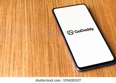 Assam, india - April 10, 2021 : GoDaddy logo on phone screen stock image.
