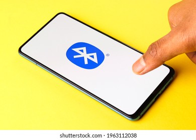 Assam, india - April 10, 2021 : Bluetooth logo on phone screen stock image.