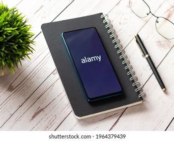 Assam, india - April 19, 2021 : Alamy logo on phone screen stock image.