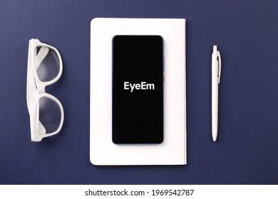 Assam, india - April 19, 2021 : EyeEm logo on phone screen stock image.