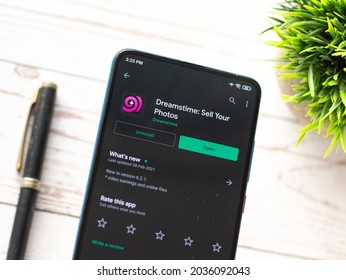 Assam, india - April 19, 2021 : Dreamstime logo on phone screen stock image.