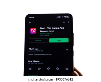 Assam, india - March 10, 2021 : Woo app logo on phone screen stock image.