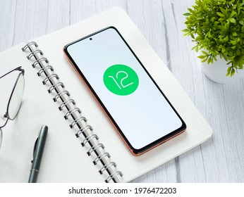 Assam, india - May 19, 2021 : Android 12 logo on phone screen stock image.