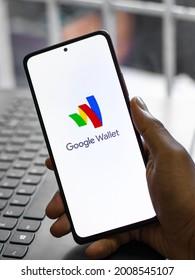Assam, india - May 29, 2021 : Google wallet logo on phone screen stock image.