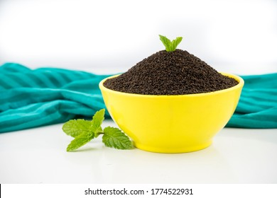 Assam Indian black tea (chai)  Patti Powder Served in White bowl,Red Bowl, Yellow Bowl, Glass bowl. and white background photography
