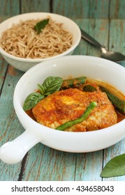 Assam Pedas fish curry / Fish cooked in sour and spicy gravy with tomatoes and okras, selective focus