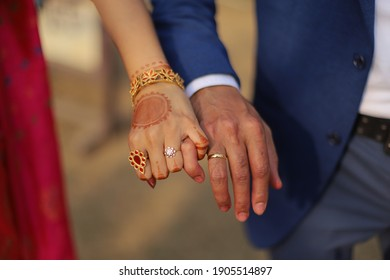 Assamese Bride and Groom holding hands on their ring ceremony