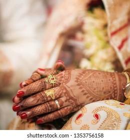 An assamese bride's folded hand in her wedding day