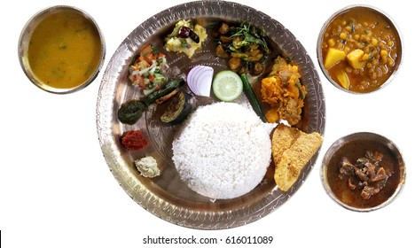 Assamese thali with duck curry, served in bell metal utensils , food culture of Assam, India.