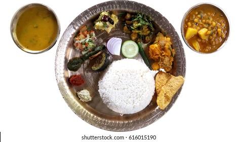 Assamese Traditional Thali in bell metal utensils, food culture of Assam.