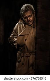 Assassin Stalker - Russian Spy - Man with Hand in Trench Coat - Creepy Killer Lurking in Doorway - Dangerous Hitman in Shadows - Stranger Stalking with Gun - Noir Style Secret Agent Vintage Detective