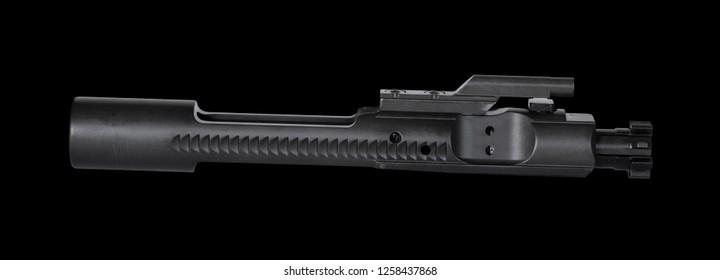 Assault rifle bolt carrier group on a black background