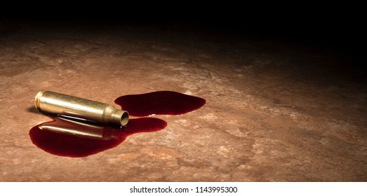 Assault rifle cartridge that has been shot on a tan floor