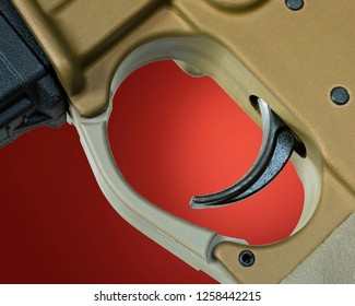 Assault rifle trigger with a red background behind