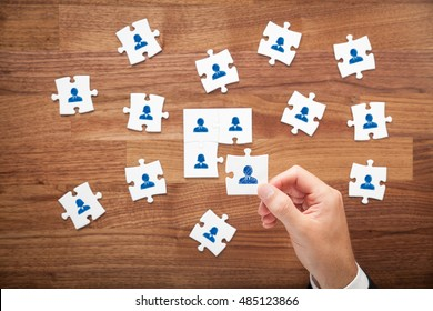 Assemble a team cencept. Business team, human resources cooperation, connection and unity concepts. Good team fit together like puzzle pieces.