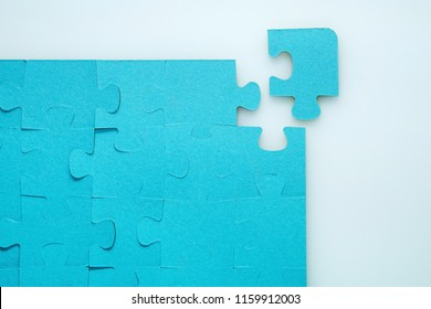 Assembled puzzle on a white background without one element