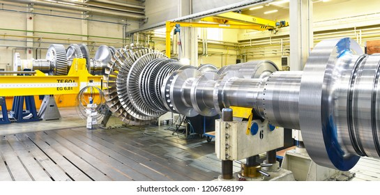 assembling and constructing gas turbines in a modern industrial factory
