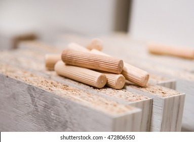 Assembling of furniture, wooden dowels on wooden boards