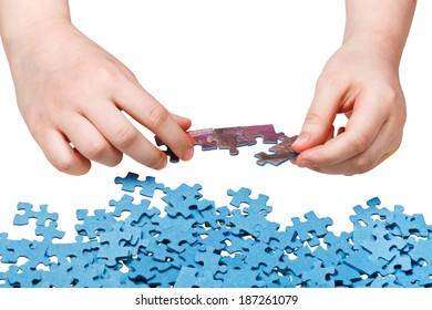 assembling of jigsaw puzzles isolated on white background