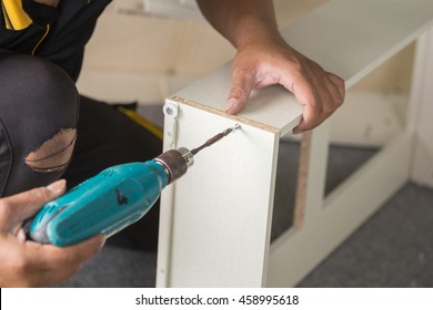Assembling new furniture with a screwdriver