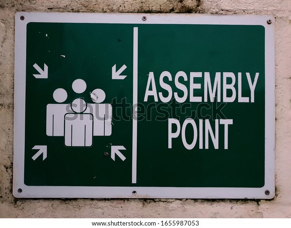 Assembly Point sign mounted on the wall in Bray, Co. Wicklow, Ireland. A close up view.