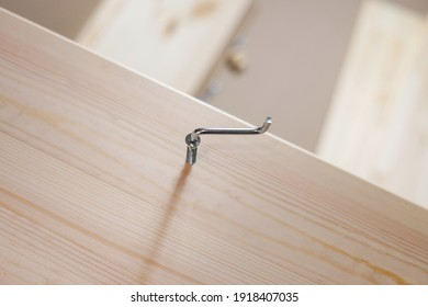 Assembly process for wooden furniture. Hex screwdriver.