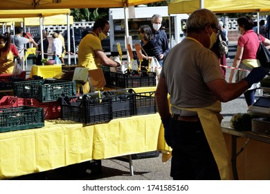Assemini / Italy - May 26 2020: open air vegetable market during Coronavirus pandemia