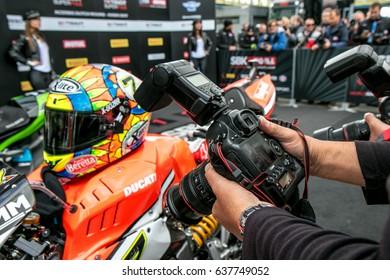 ASSEN NETHERLANDS - APRIL 29.+30, 2017: World Superbike Race WSBK - Helmet and Photografer