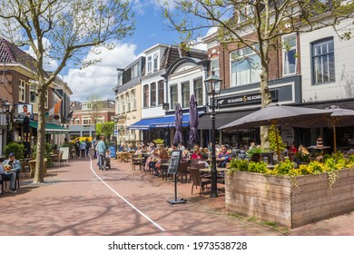 ASSEN, NETHERLANDS - MAY 12, 2021: People enjoying the spring weather at restaurants in Assen, Netherlands