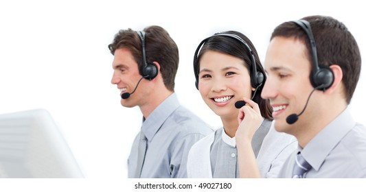 Assertive customer service agents working in a call center against a white background
