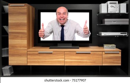 Assertive dealer attacking from tv screen on a furniture.