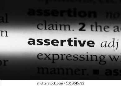 assertive word in a dictionary. assertive concept.