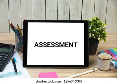 "Assessment concept. Word ""Assessment"" written on tablet"