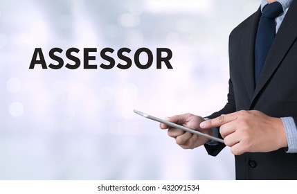 ASSESSOR Businessman use a tablet computer