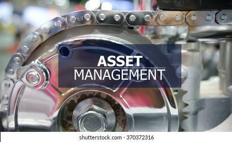 ASSET MANAGEMENT  on the Mechanism of Metal Cogwheels background ,  innovation concept , business concept, business idea