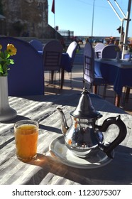 ASSILAH, MOROCCO - NOVEMBER 10, 2015: Traditional Moroccan herbal tea and oriental pot in a cafe in the historical city of Assilah