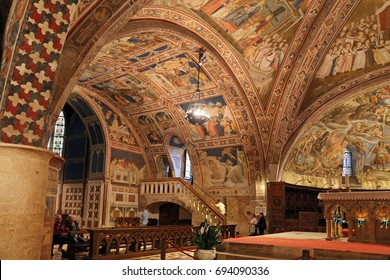 ASSISI, ITALY 30 JUNE, 2017: Interior Famous Basilica of St. Francis of Assisi (Basilica Papale di San Francesco) with Lower Plaza at sunset in Assisi, Umbria, Italy