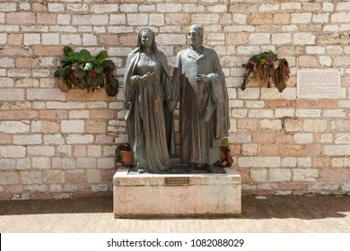 Assisi, Italy - April 08, 2018: The statue of the parents of Saint Francis of Assisi Pietro di Bernardone and Madonna Pica