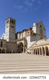 Assisi, Italy - April 08, 2018: The Basilica of Saint Francis of Assisi and the arcade near it