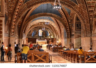Assisi, Italy August 2016: Interior of the famous Basilica of San Francesco d'Assisi (Papal Basilica of San Francesco) at sunset in Assisi, Umbria, Italy