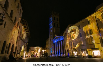 ASSISI, ITALY - DECEMBER 21, 2018: Wonderful christmas video mapping in the old palace of Assisi in Umbria, Italy