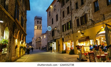 ASSISI, ITALY - DECEMBER 21, 2018: Medieval street of Assisi at night in Umbria, Italy