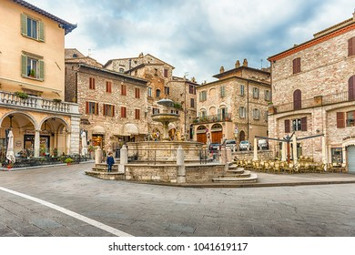 ASSISI, ITALY - JANUARY 14: View of Piazza del Comune (Town Hall Square) and the beautiful Fountain of three lions, iconic landmark in Assisi, central Italy, January 14, 2018