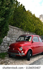 ASSISI, ITALY - MARCH 11, 2015: A small red Italian car in Assisi