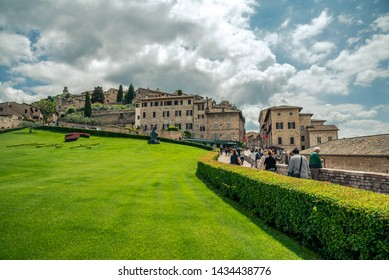 Assisi, Italy - May 22 2019: Outside the Basilica of San Francesco d'Assisi in Italy, view of Assisi, the Umbria region, Italy.